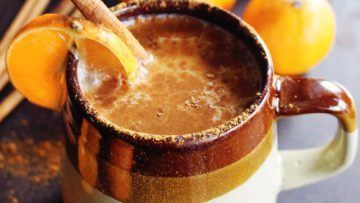 vegan almond milk chai with whiskey and orange juice