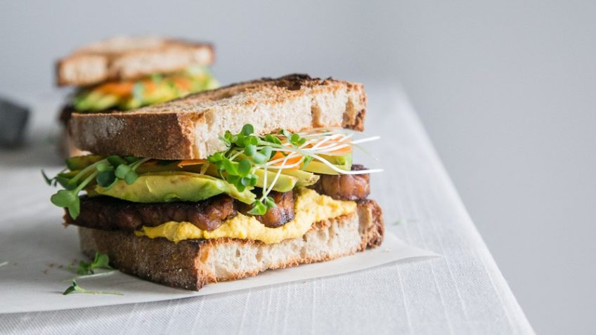 vegan tempeh sandwich with carrot aioli