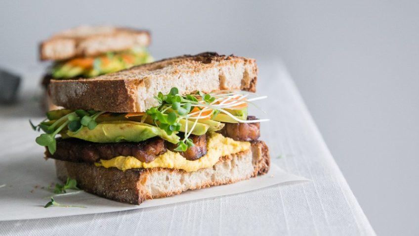 vegan tempeh sandwich with carrot aioli